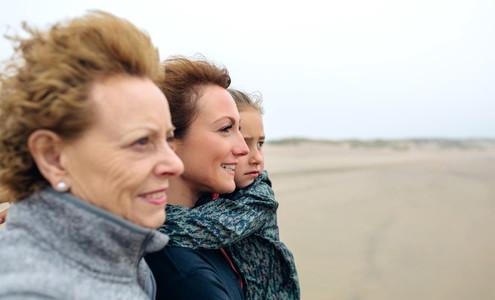 Three generations female looking at sea