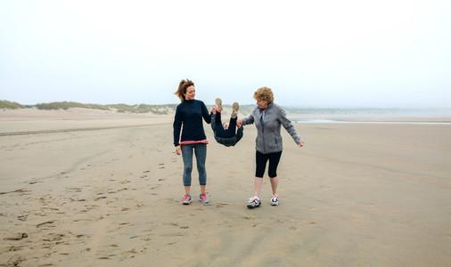 Three generations female walking on the beach