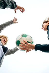 Three generations playing with soccer ball