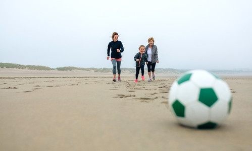 Soccer ball with three running people