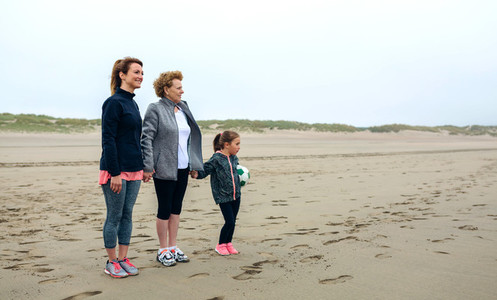 Three generations female watching the sea