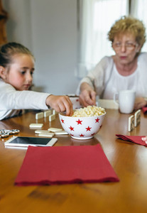 Grandmother and granddaughter playing domino
