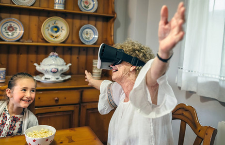 Senior woman using virtual reality glasses