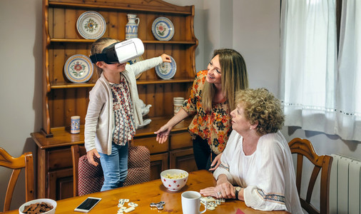 Senior woman using virtual reality glasses