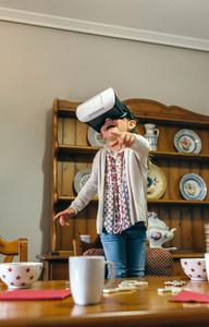 Little girl using virtual reality glasses