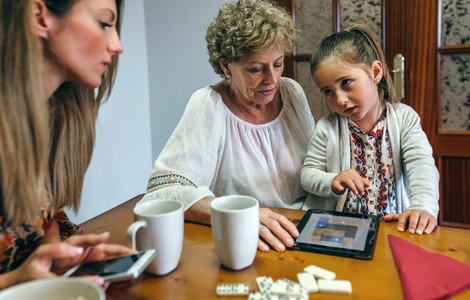 Little girl asking permission to continue playing tablet