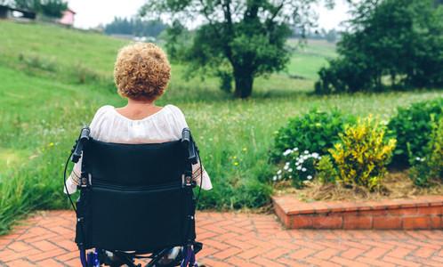 Unrecognizable senior woman in a wheelchair