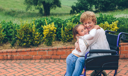 Granddaughter hugging her grandmother
