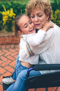 Granddaughter hugging her grandmother