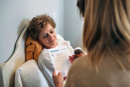 Doctor giving a prescription to senior patient