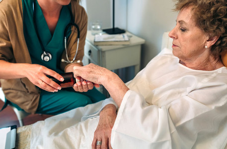 Doctor giving medication dose to elderly patient