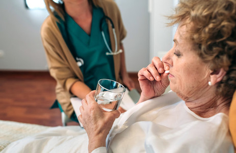 Senior patient taking a pill