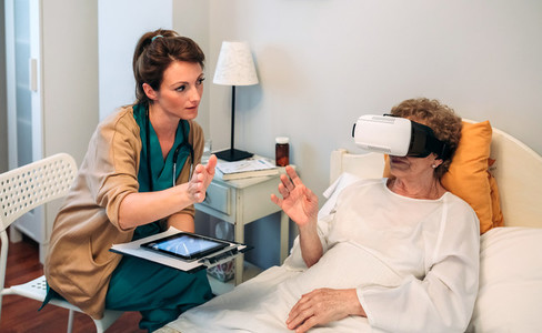 Older patient using virtual reality glasses