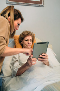 Female doctor showing results of a medical test on the tablet