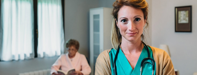 Pretty female doctor posing in a geriatric clinic
