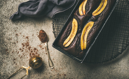 Chocolate banana cake with cinnamon in baking tin  horizontal composition