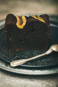 Piece of dark chocolate banana bread cake dessert on plate