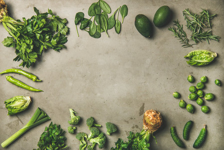 Healthy vegan ingredients layout over concrete table background  copy space