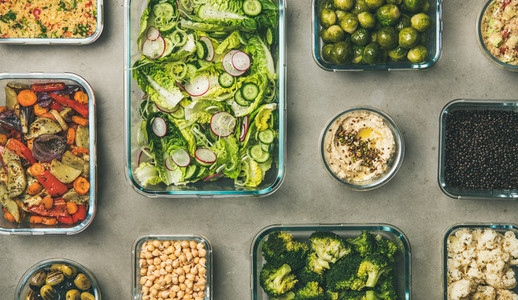 Various healthy vegan or vegetarian dishes in glass containers