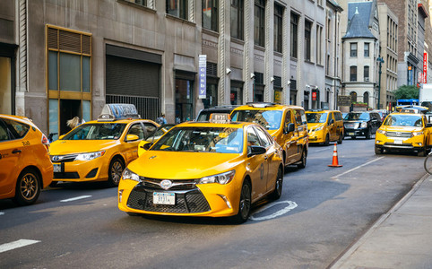 Yellow cabs on the busy traffic of Manhattan  in New York City  USA