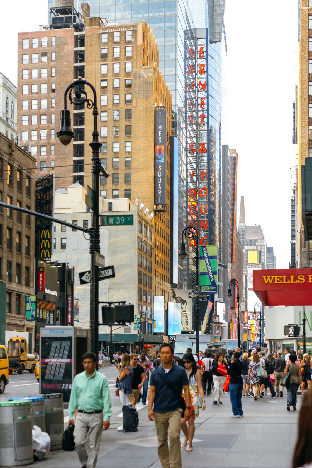 People walking by 7th Avenue in Manhattan  New York City  USA