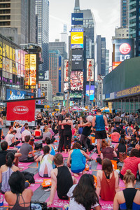 People in the yoga annual concentration in Times Square New York City USA