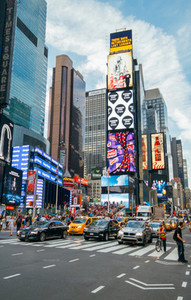 People and led advertising panels in Times Square  New York City  USA