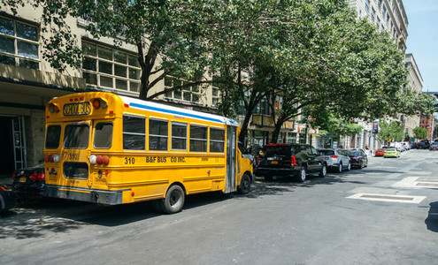 Yellow school bus parked on the street of New York City