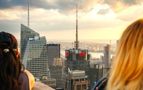 Tourist looking skyline of Manhattan at dusk in New York City