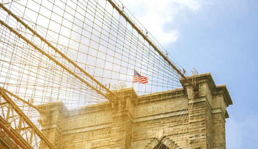 Towers and American flag over Brooklyn Bridge
