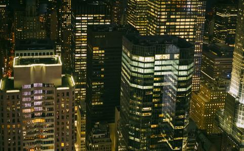 Skyscrapers windows illuminated at night in Manhattan