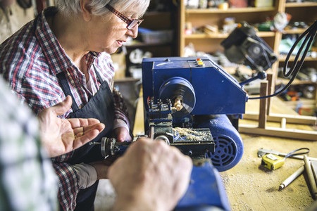 Senior woman in a carpentry