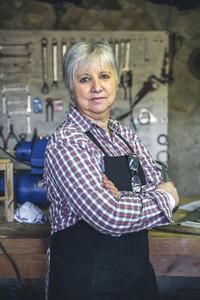 Female carpenter in his workshop