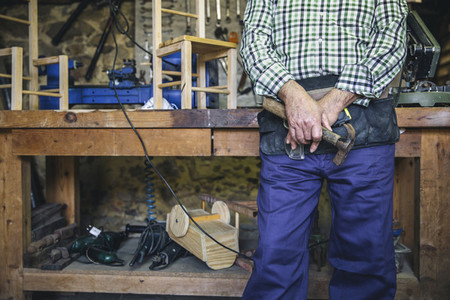 Unrecognizable carpenter holding a hammer