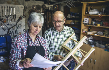 Senior couple in a carpentry