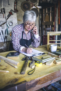 Female carpenter in his workshop