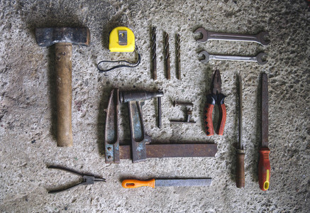 Carpenter tools on concrete background