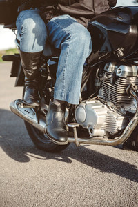 Couple sitting over motorcycle ready to go