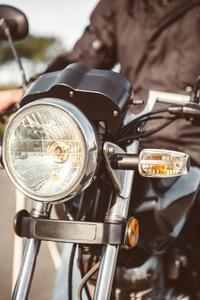 Motorcycle headlights with senior man steering