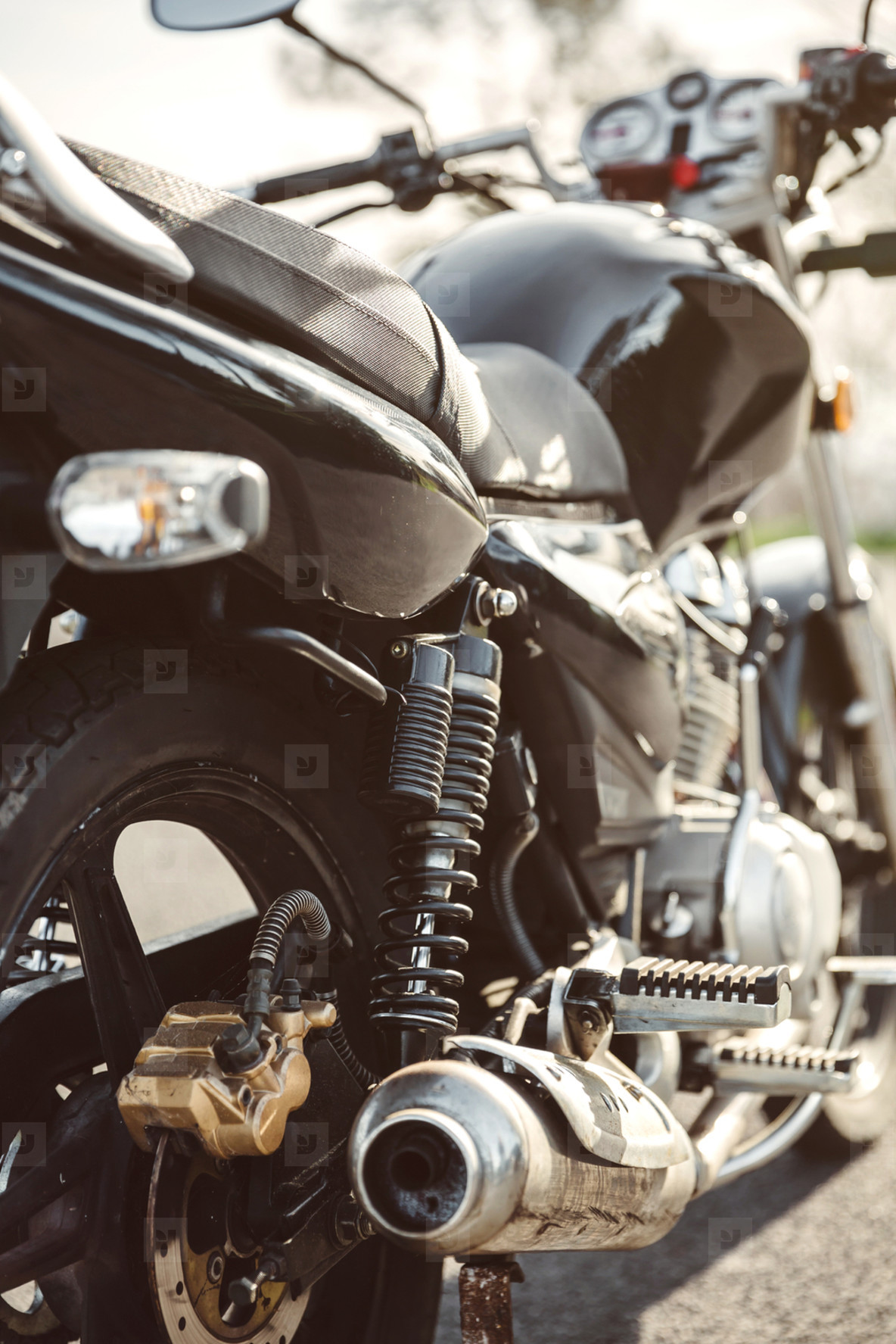 Shock absorber and exhaust pipe of black motorcycle