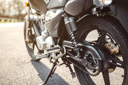 Shock absorber and chain of black motorcycle