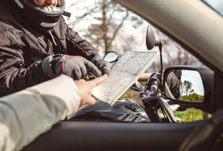 Motorcyclist asking to map direction
