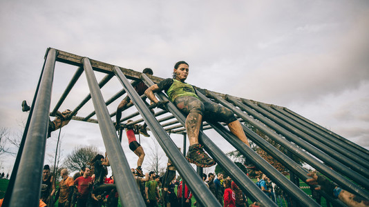Runner going down structure in a test of extreme obstacle race