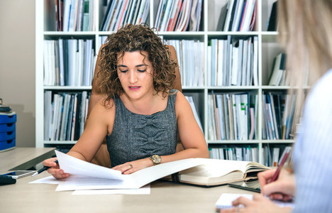 Businesswoman and secretary working with documents in office