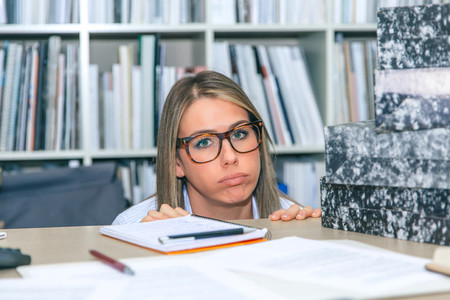 Exhausted secretary with lot of work in office