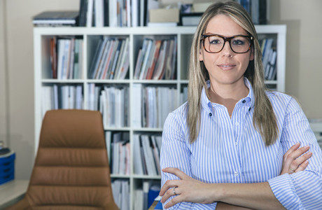 Portrait of young smiling businesswoman in office