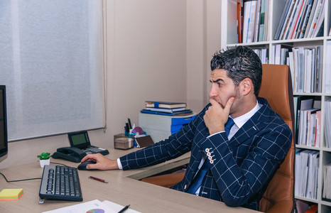 Businessman working with computer in the office