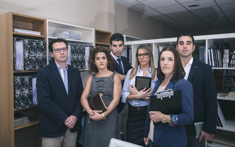 Colleagues in office standing ready for meeting