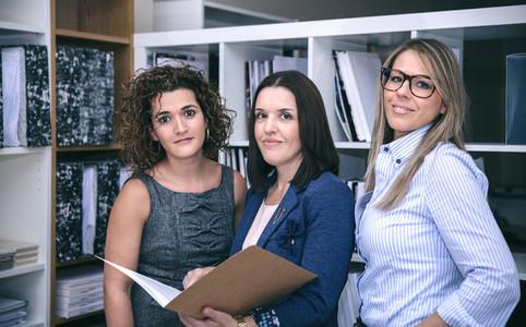 Three businesswomen standing working in the office
