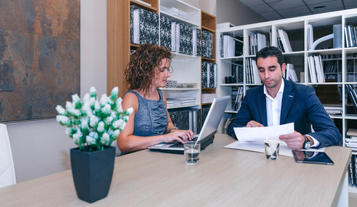Businesspeople working together at table in office